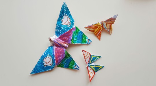 Three colourful, homemade origami butterflies