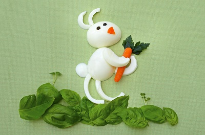 Bunny made out of boiled eggs, carrots and spinach
