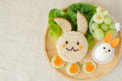 sandwich cut into the shape of a bunny with a side of egg, spinach and grapes