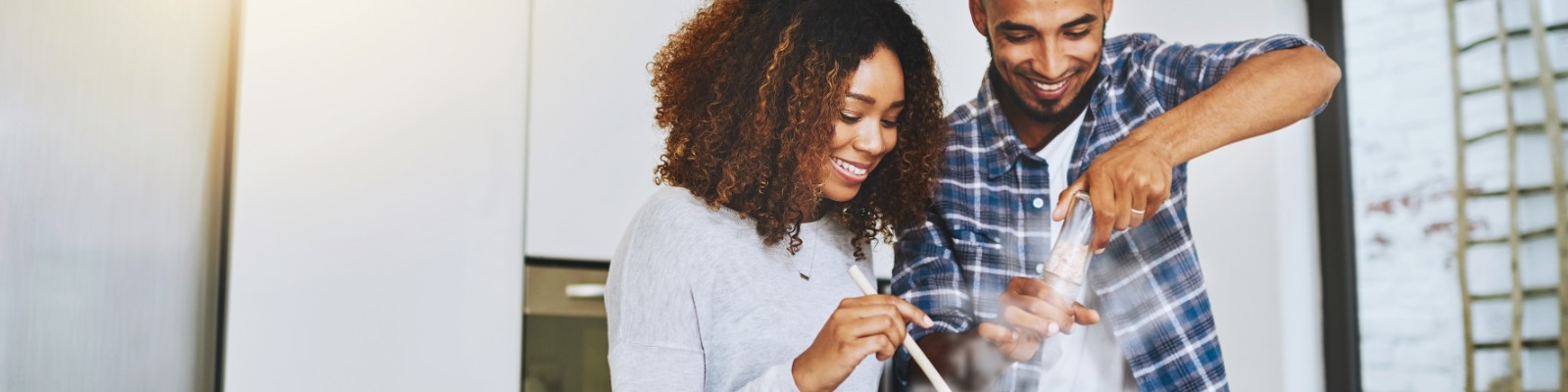 Happy man and woman cooking healthy recipe