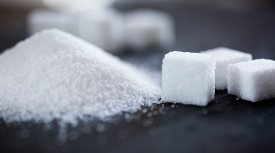 Sugar cubes and mound of sugar