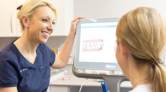 Bupa Dental Care patient viewing iTero scan model with a Bupa dentist