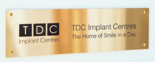 TDC Implant Centres gold plaque