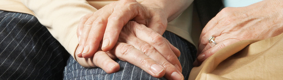 A photo of hands holding.