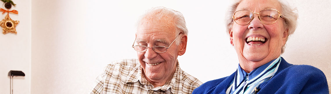 a photo of a senior couple laughing
