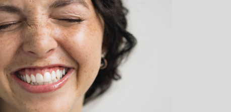 a close up picture of a woman laughing