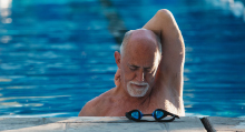 A man stretching in a swimming pool