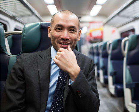man smiling on a train