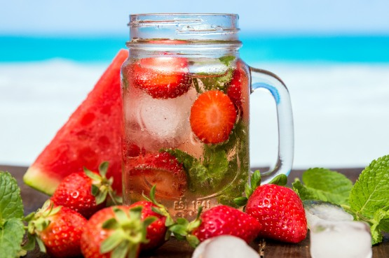 A mason jar of strawberries, mint and water