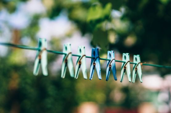 Pegs hanging on a washing line