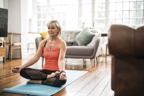 middle-aged-woman-doing-yoga