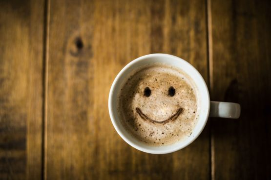 Coffee cup with a smiley face