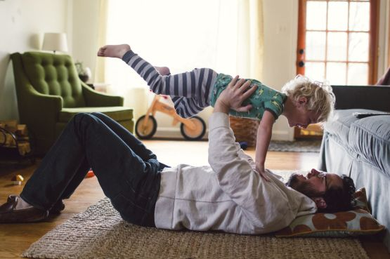 A dad and baby playing at home