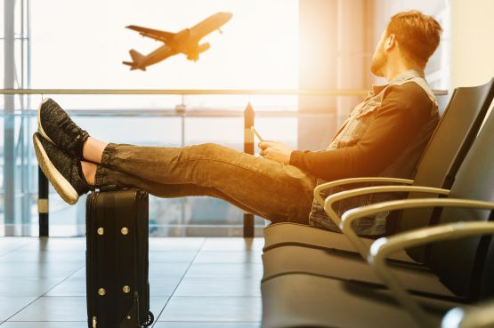 An image of a man waiting at the airport
