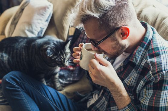 An image of a man with a cat