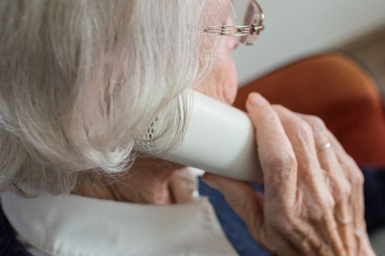 an older woman on the phone