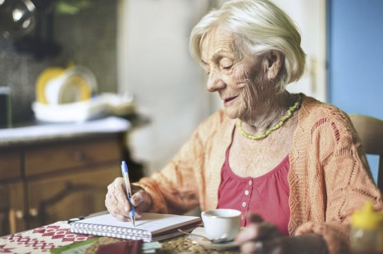 an older lady writing