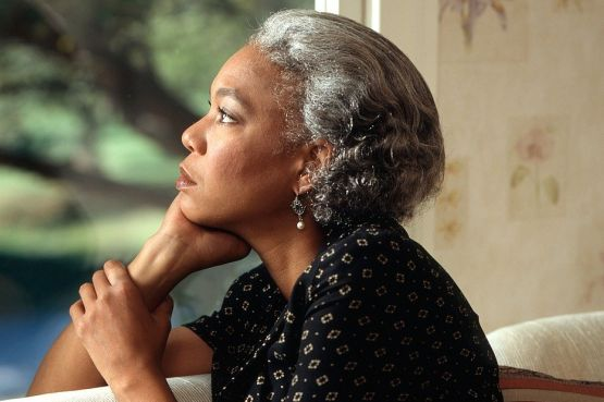 woman looking pensively out of the window