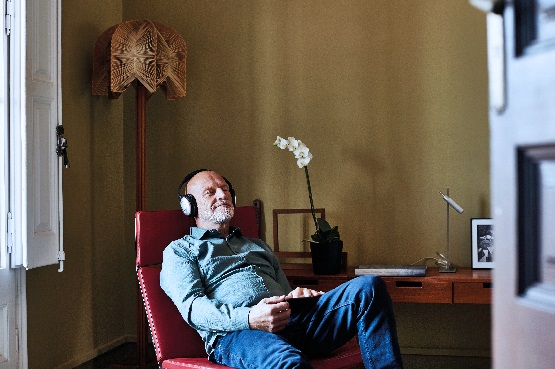 a senior man listening to music at home
