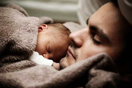Sleeping man and baby
