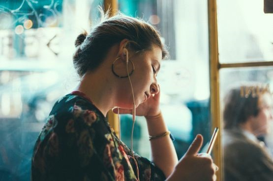 An image showing a woman on her phone