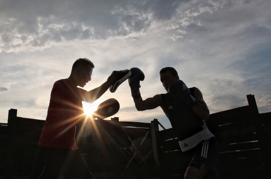 two men boxing outdoors