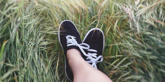Feet lying on the grass