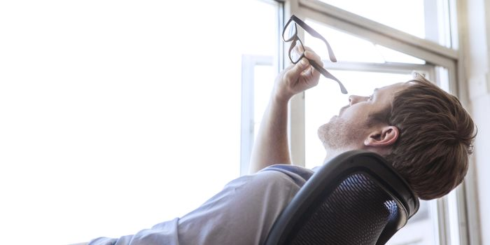 A man is relaxing on a chair