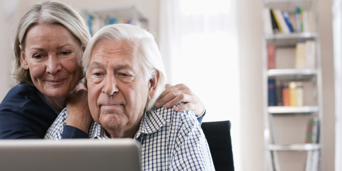 an older couple on a laptop