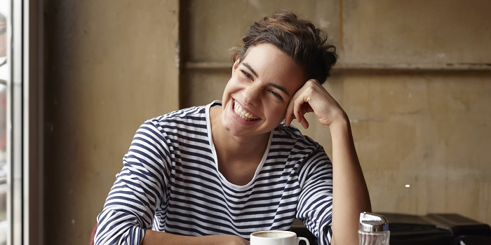 A smiling woman in a cafe