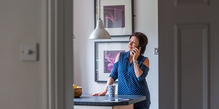 a woman on the phone at home