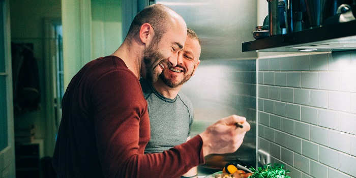 two men cooking at home