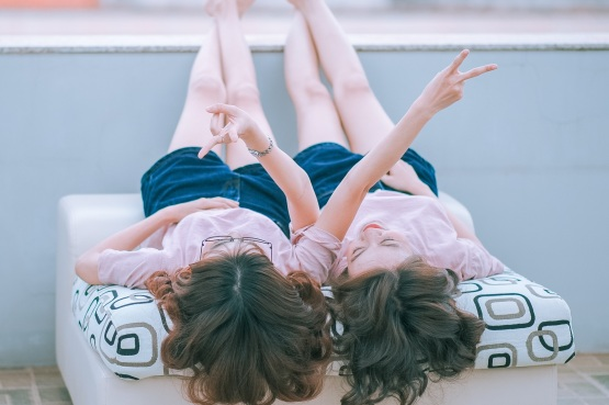 Image of two young girls lay side by side.