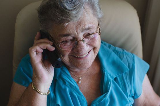 An elderly lady on the phone