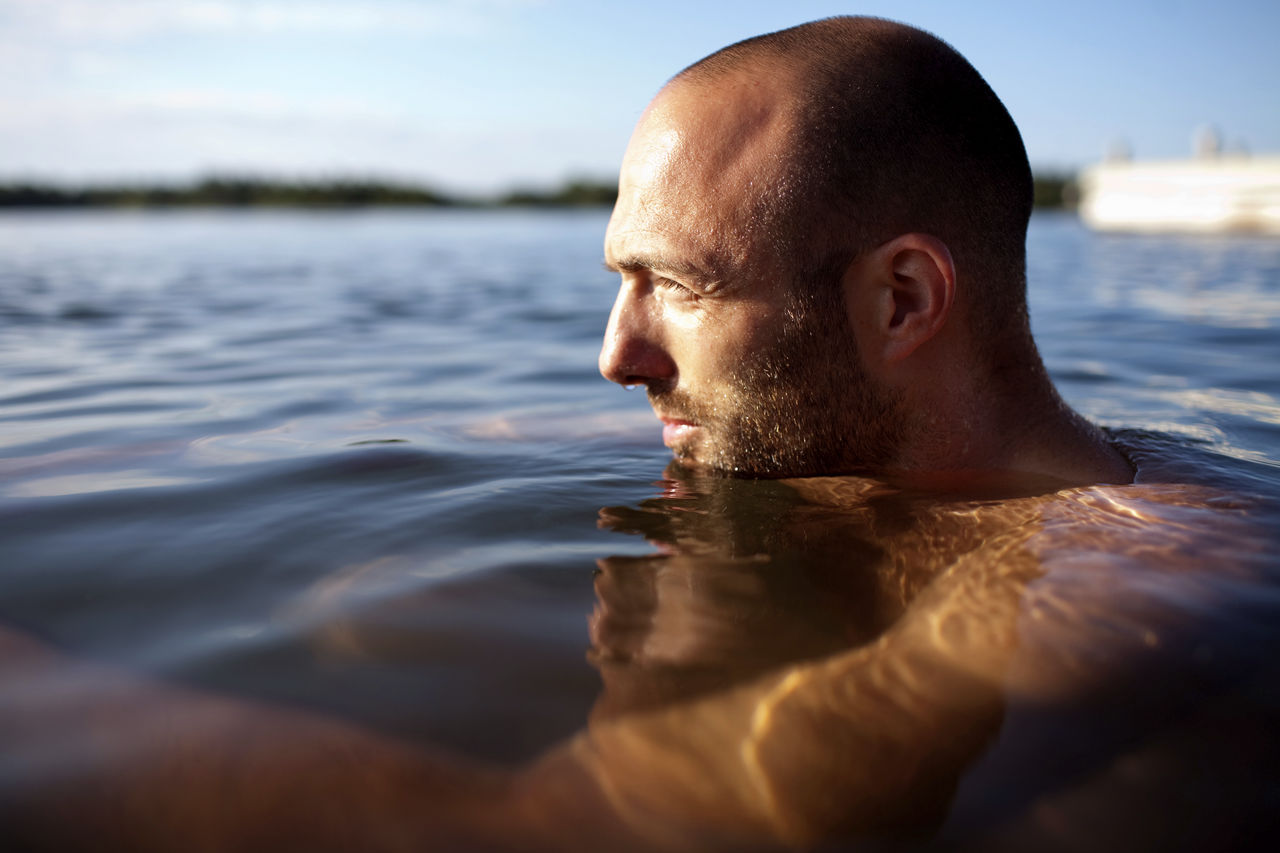 An image showing a man swimming outdoors
