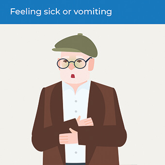 An image showing someone feeling sick, a symptom of a heart attack