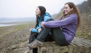 Two women resting on a hike