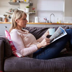 A woman relaxing on a sofa - on a personal story about endometriosis