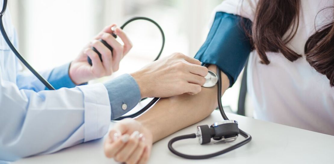 doctor taking a person's blood pressure