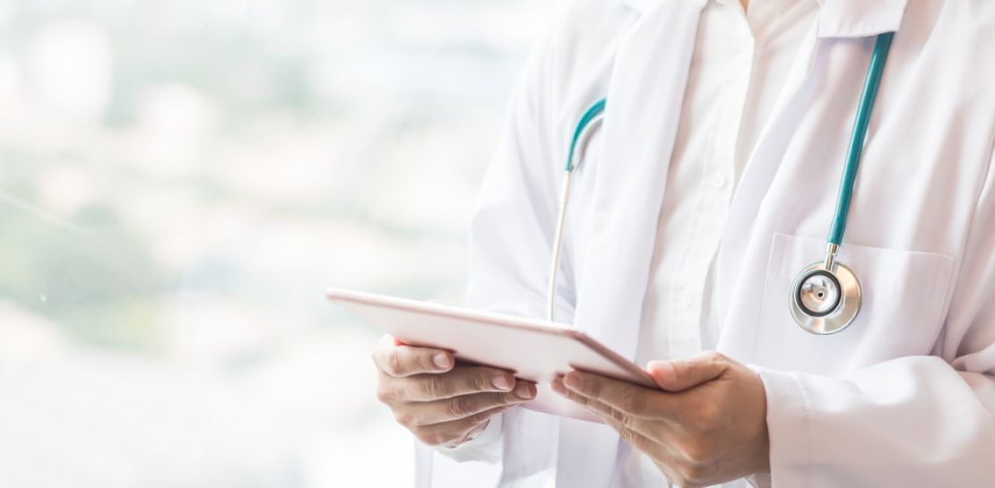 A doctor with a tablet in hand