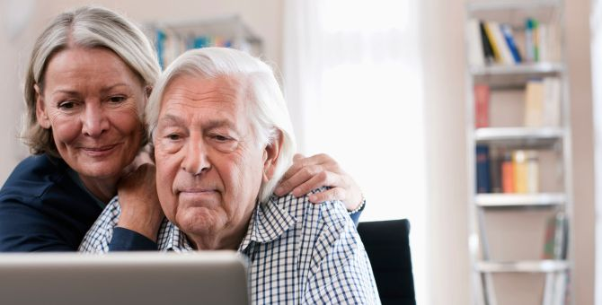 An older couple looking at a computer