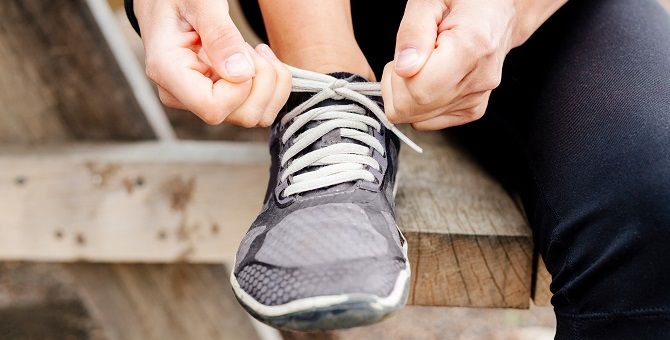 A person fastening their trainers