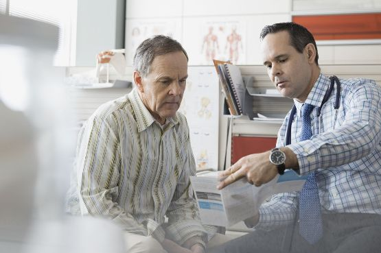 An image showing a doctor talking to a patient