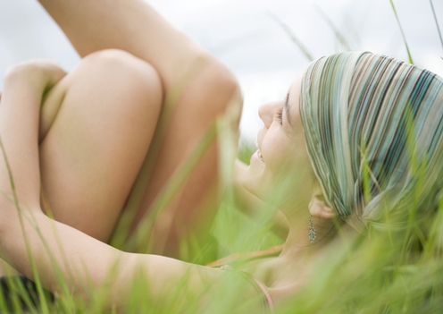 lady relaxing in long grass
